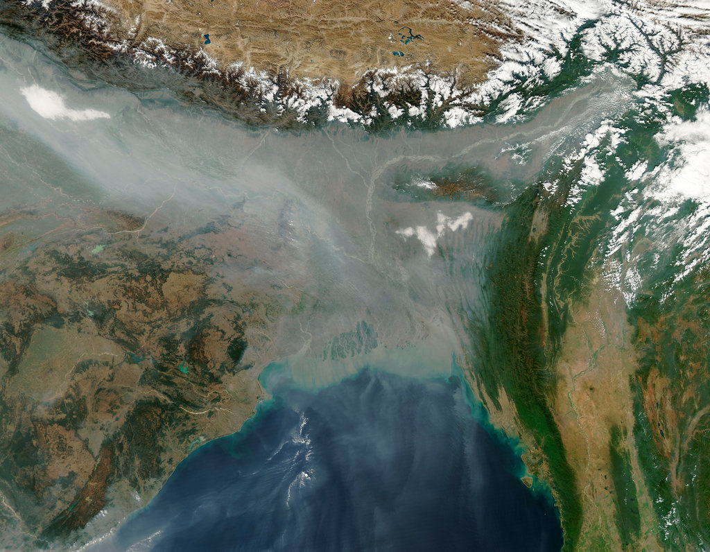 Jan. 10, 2013: In this photo from NASA's Aqua satellite, haze below the Himalayas blankets Northern India and Bangladesh, likely the result of fires, urban and industrial pollution, and a meteorological phenomenon called temperature inversion.