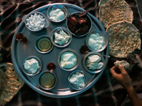 """A palate of whites. A nomad breakfast—yoghurt, goat cheese, roasted peppers, honey. Mt. Karacadag, Turkey."" (Image source: Facebook Out of Eden Walk page)"